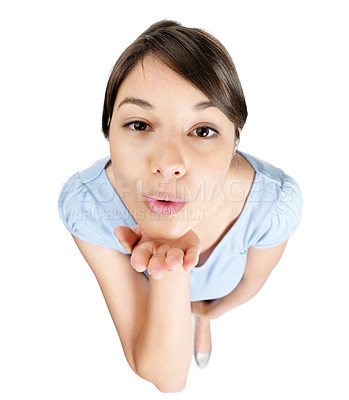 Buy stock photo Top view of a cute young female blowing a kiss at you on white background