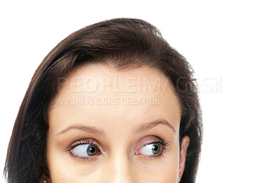 Buy stock photo Cropped image of a beautiful young woman looking at your product against white background