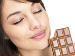 Happy young female eating chocolate