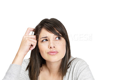 Buy stock photo Portrait of a young woman thinking about something while looking away
