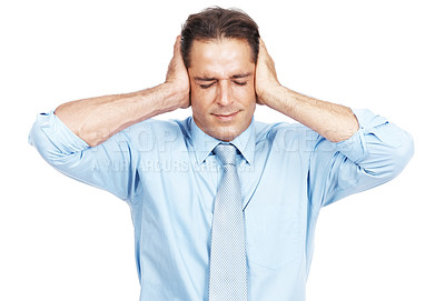 Buy stock photo Studio shot of a businessman covering his ears isolated on white