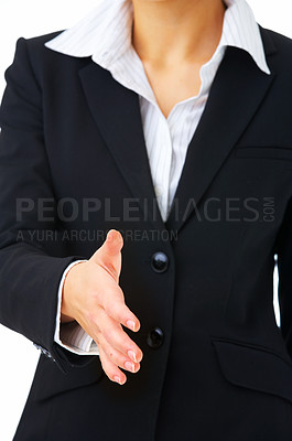 Buy stock photo Extreme close up of a young businesswoman reaching out to shake somebody's hand..