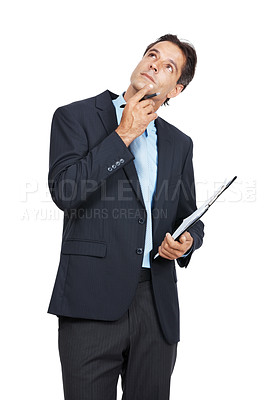 Buy stock photo A businessman looking thoughtful while holding a clipboard against a white background