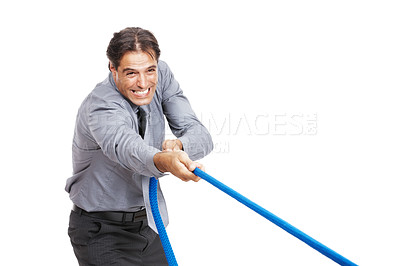 Buy stock photo Shot of a businessman pulling a rope against a white background