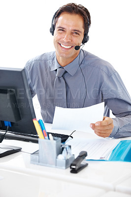 Buy stock photo Portrait of a smiling business man with headset sitting in office holding a paper