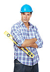 Young handyman with a spirit level against white background