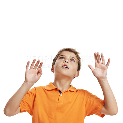 Buy stock photo Portrait of a surprised little boy looking up at copyspace with hands up in air isolated on white background