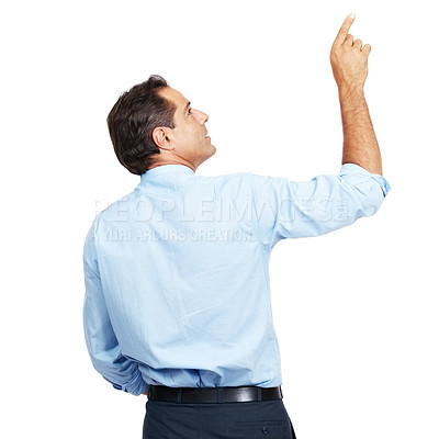 Buy stock photo Rearview shot of a businessman pointing up at copyspace
