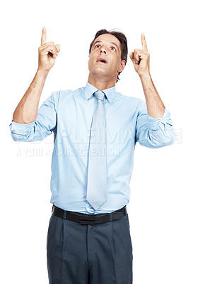 Buy stock photo Shot of a mature businessman pointing up at copyspace with both hands