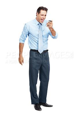 Buy stock photo Studio shot of an angry businessman yelling into his cellphone against a white background