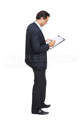 Buy stock photo A businessman writing something on a clipboard against a white background