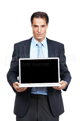 Buy stock photo Studio shot of a mature businessman holding up a laptop with a blank screen