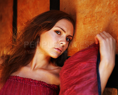 Buy stock photo Portrait of an attractive young woman posing amongst colorful fabric