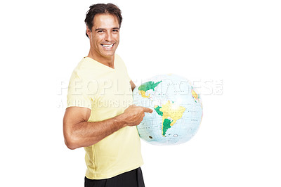 Buy stock photo Shot of a man pointing at the globe he's holding against a white background