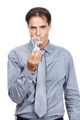 Buy stock photo Shot of a businessman holding a lightbulb while standing against a white background
