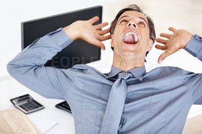 Buy stock photo Excited mature business man screaming in victroy while sitting at his office desk