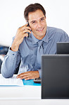 Confident business executive using cellphone at work
