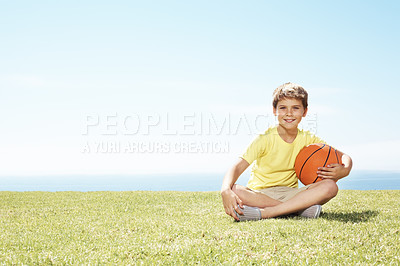 Buy stock photo Portrait of happy kid sitting on grass with a basketball  - Lots of copyspace