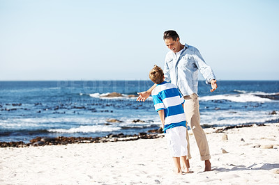 Buy stock photo Portrait of happy father an son having fun at the beach on a summer day