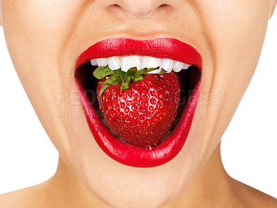 Buy stock photo Closeup of a young girl mouth with a strawberry against white background