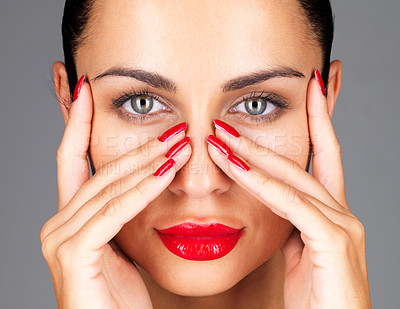 Buy stock photo Closeup portrait of a gorgeous young woman posing with hand on her face