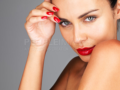 Buy stock photo Closeup portrait of a sexy young female fashion model posing against grey background
