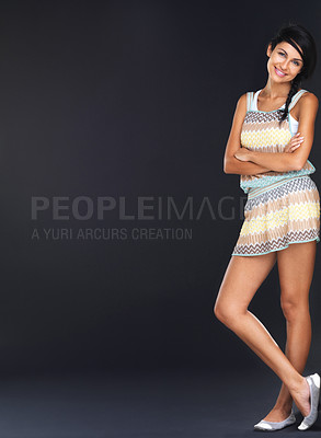 Buy stock photo Full length of a gorgeous young girl standing with hands folded over grunge background with large copyspace