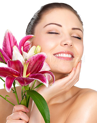 Buy stock photo Sensuality and wellness - Beautiful portrait of a young sexy woman smelling the flowers.