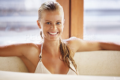 Buy stock photo Smiling young beauty enjoying jacuzzi at spa center