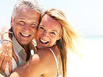 Cheerful mature couple together at the beach