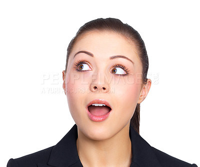 Buy stock photo Suprised girl looking at copy space - Portrait of a beautiful young business woman, looking up.