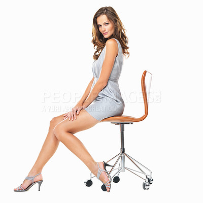 Buy stock photo Full length of cute young lady sitting on chair against white background