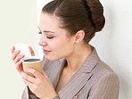 Business woman smelling coffee