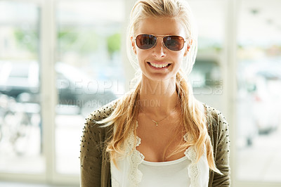 Buy stock photo Smiling young woman wearing trendy sunglasses and smiling