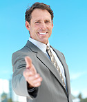 Portrait of a businessman ready for hand shake