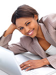 Happy successful business woman lying by laptop
