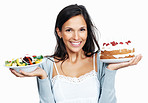 Pretty woman holding cake and salad