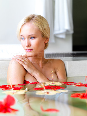 Buy stock photo Beautiful young woman looking away in thought while taking bath