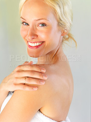 Buy stock photo Happy young lady wrapped in towel looking over her shoulder