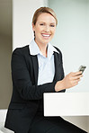 Cheerful attractive business woman holding a mobile phone