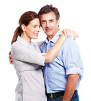 A cute mature couple hugging eachother over white background