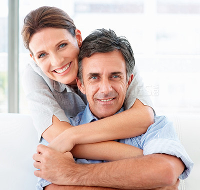 Buy stock photo Closeup portrait of an attractive mature couple embracing and smiling at you - copyspace