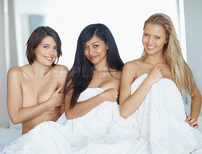 Buy stock photo Three happy young women nude in bed