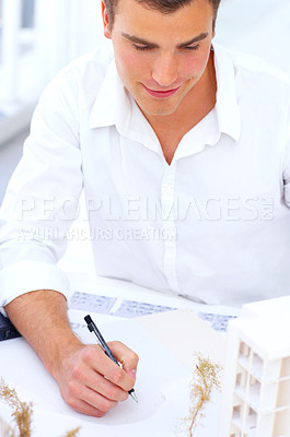 Buy stock photo Cropped shot of a male architect working on a new building plan