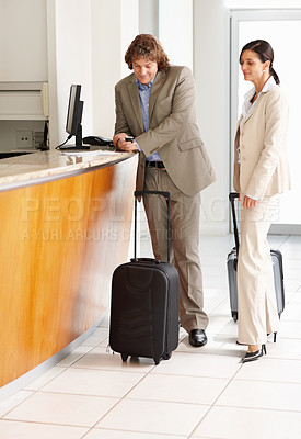 Buy stock photo Full-length of mature business associates waiting at the hotel reception with luggage