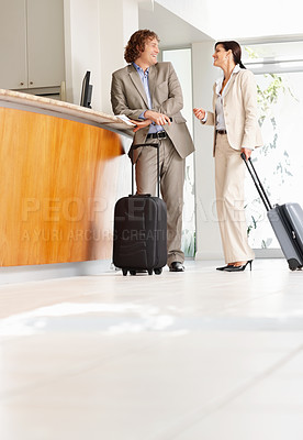 Buy stock photo Full-length of a mature business associates having a chat at the reception with luggage