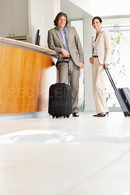 Buy stock photo Full-length portrait of two business associates waiting at the hotel reception