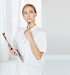 Mature nurse with notepad looking at copyspace in thought