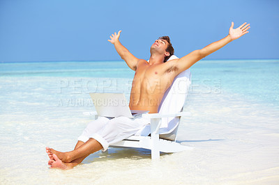 Buy stock photo Portrait of peaceful man stretching arms with laptop on beach