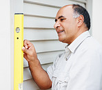 An experienced maintenance guy working a spirit level tool